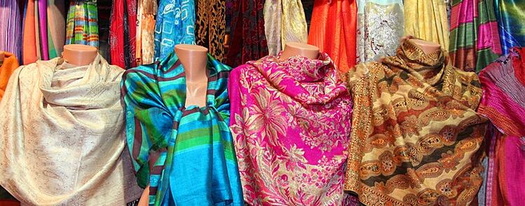 stock-photo-colorful-scarfs-in-line-at-market-27456772