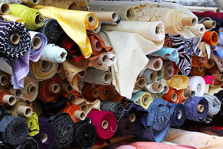 stock-photo-fabric-rolls-in-shelf-for-fashion-industry-91500470
