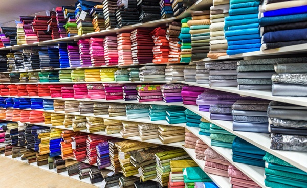 stock-photo-rolls-of-fabric-and-textiles-in-a-factory-shop-or-store-or-bazar-multi-different-colors-and-331556582