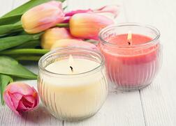 stock-photo-yellow-and-pink-aroma-candles-with-tulips-spa-composition-toned-vintage-602776505